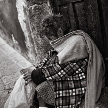 Beggar lady that I was seeing around town of San Miguel. She was taking a rest from climbing a steep street that we lived on.