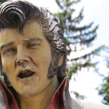 This image was taken in Borovets, Bulgaria. The cold weather surely played a role in the deterioration of this sculpture lending a surreal appearance to the famous singer.