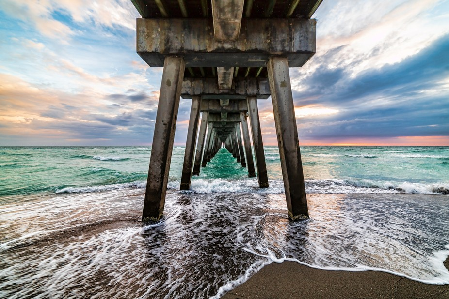 Went to Florida and while there I caught this sunset from underneath Sharky's pier.  I R...