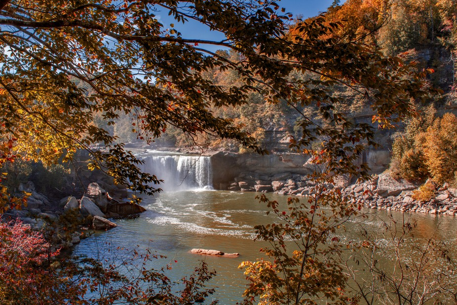 Photograph of Cumberland Falls through the autumn foliage, is dramatic any time of year.