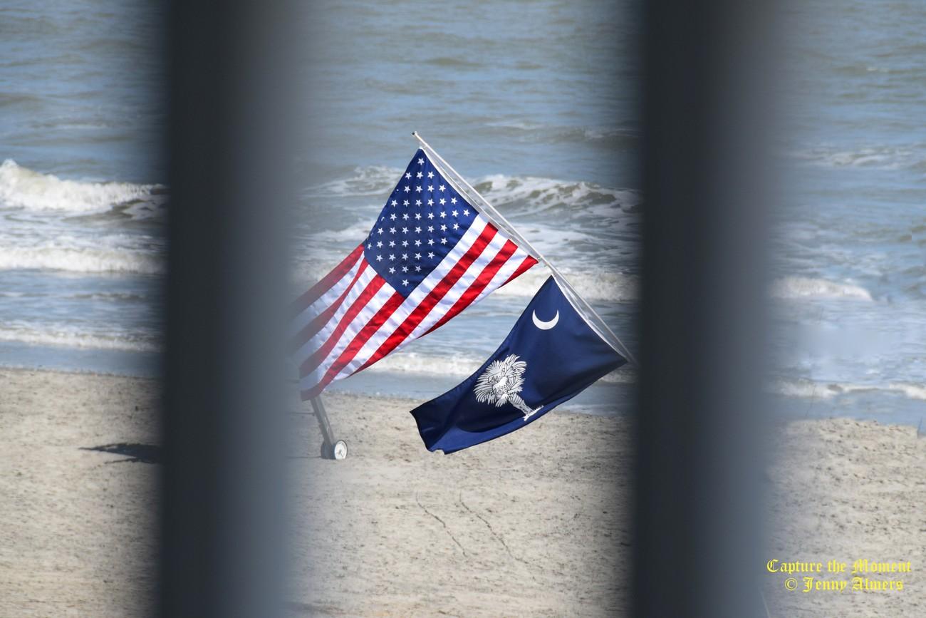 Flags Through the Railing at Folly Beach