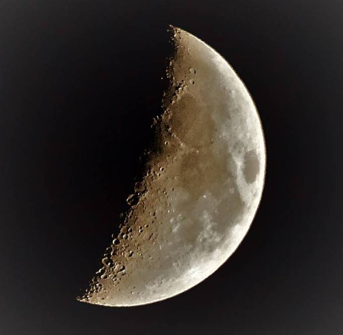 Moon Nov. 25, 2017 about 6:00 PM CDT color enhanced to increase detail.   Th