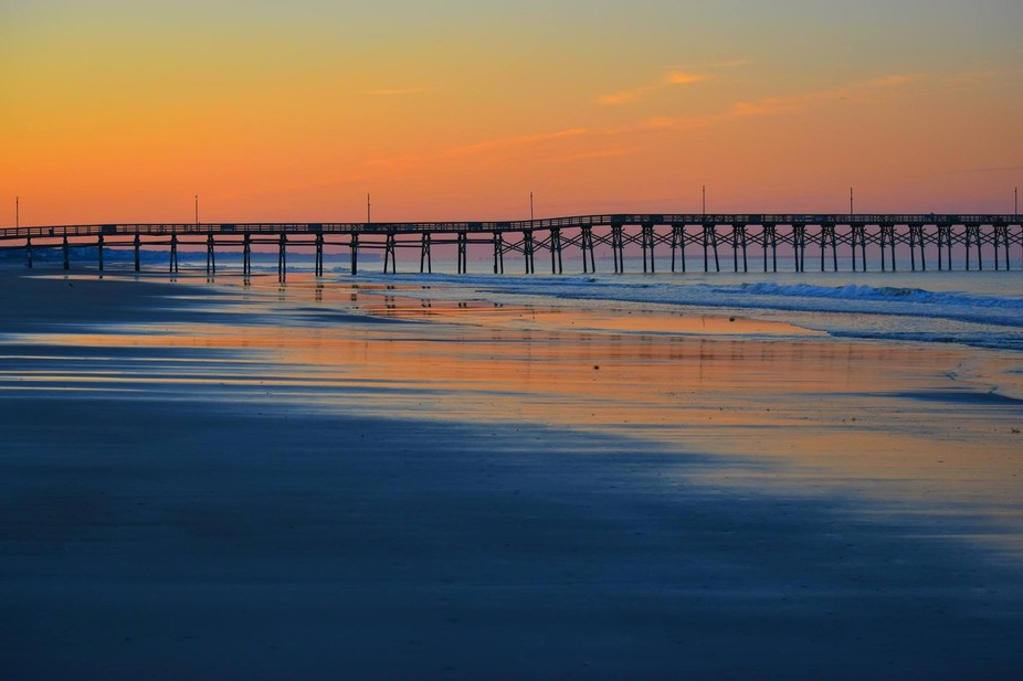 This was taken on an early morning walk on a beach in NC when the sunrise was coming up across to...