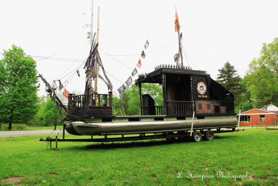 Pirate ship built on a pontoon boat that I captured on a small road trip. Has a kitchen on the ba...
