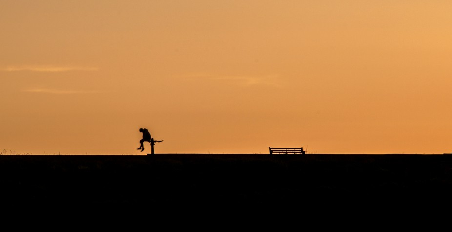 I was out shooting the sunset on the beach when I spotted this lone silhouetted figure sitting on...