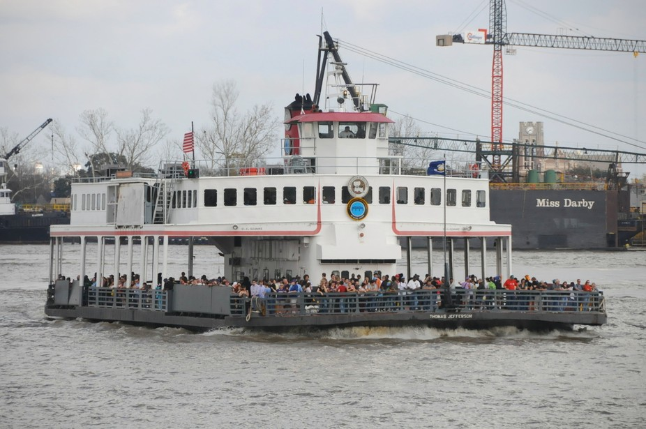 Canal St. ferry Thomas Jefferson crossing the Mississippi River on Mardi Gras Day.