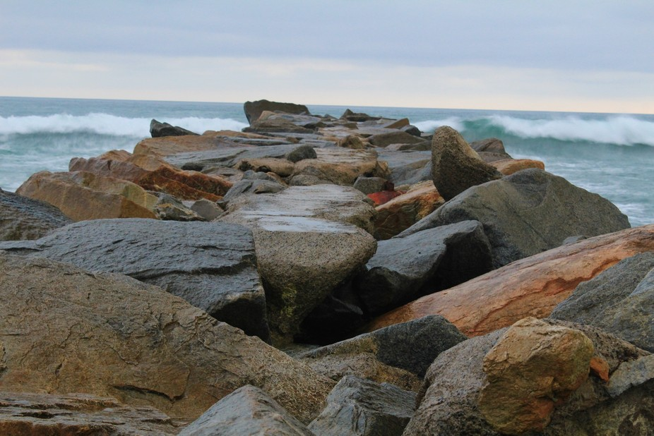 I was walking the harbor in Oceanside, California and the rocks caught my attention. I walked out...