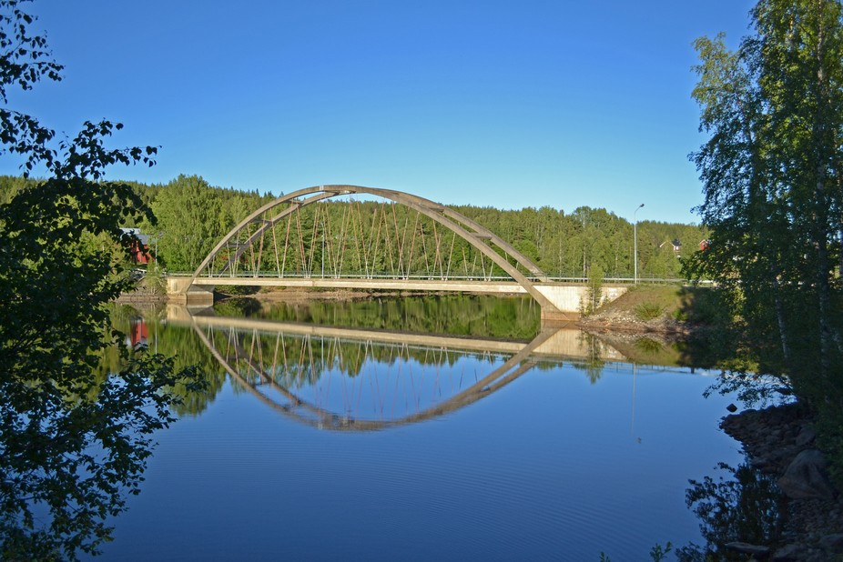 A view in the mirror of my car. I stopped to take this beautiful picture of a bridge over Umeälv...