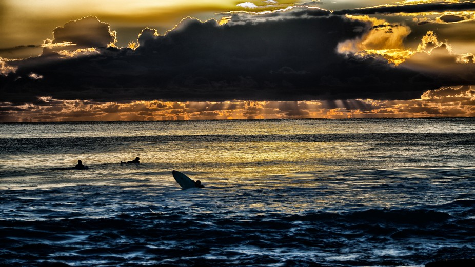A moody Sunrise over the Gold Coast Queensland, Australia, while the Surfers await the perfect wa...