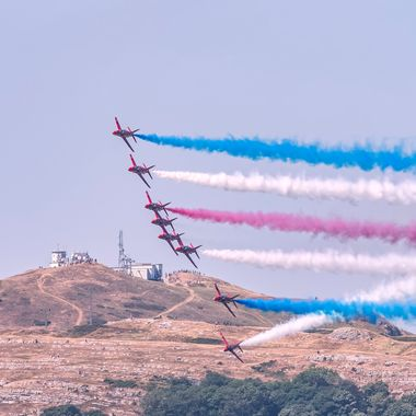 Colourful display by The Red Arrows over the Great Orme at Forces Day 2018 at Llandudno. A celebration of our Armed Forces