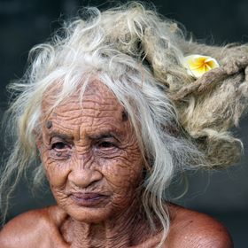 A Balinese elder just sitting by the road who agreed for me to photograph her.