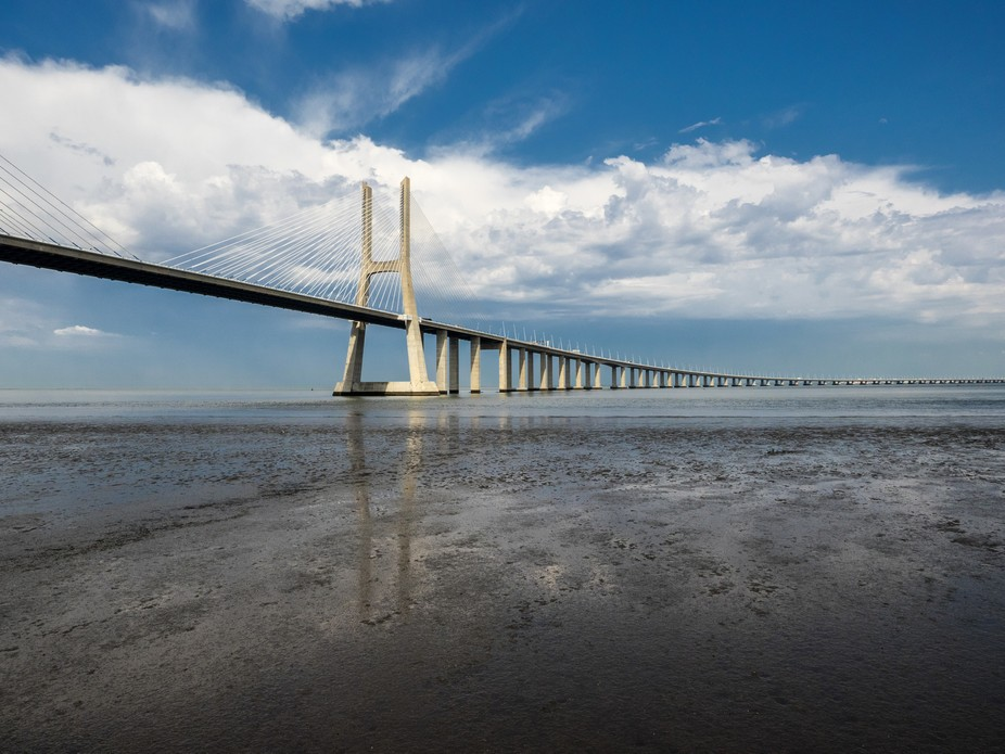 The Vasco da Gama Bridge is the  second longest bridge in Europe and spans the Tagus River in Par...