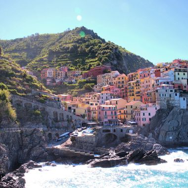 View of Manarola, Cinque Terra, Italy.  I had one of the best chocolate croissants at the cafe under the canopies.