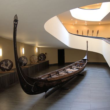 This canoe is near the entry, and at the bottom of a modern spiral staircase at the Vatican Museum.