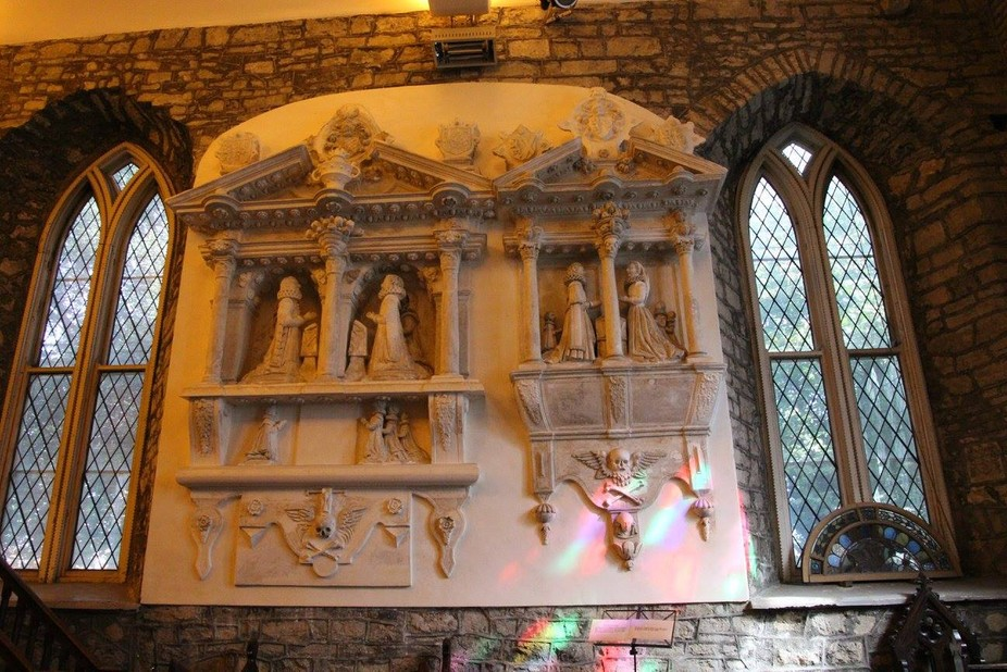 Monument in St. Audoens Church, Old Dublin City, Ireland.  The figures on the right are a monumen...