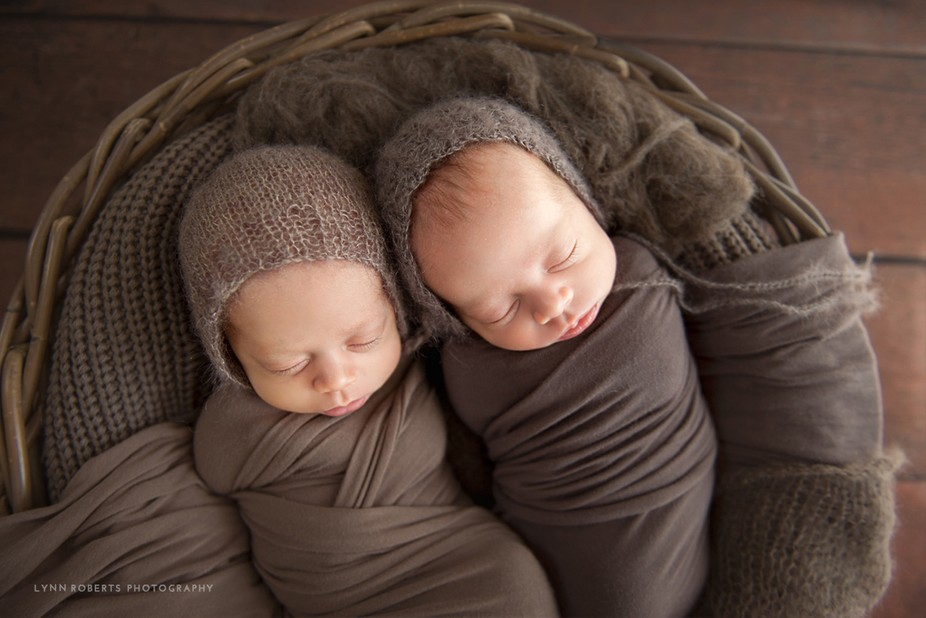 Super sweet twin boys all snuggled up in beanies in my newborn studio.