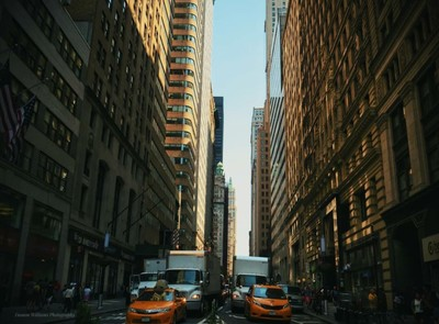 New York City streets and on the left hand side is the U.S flag