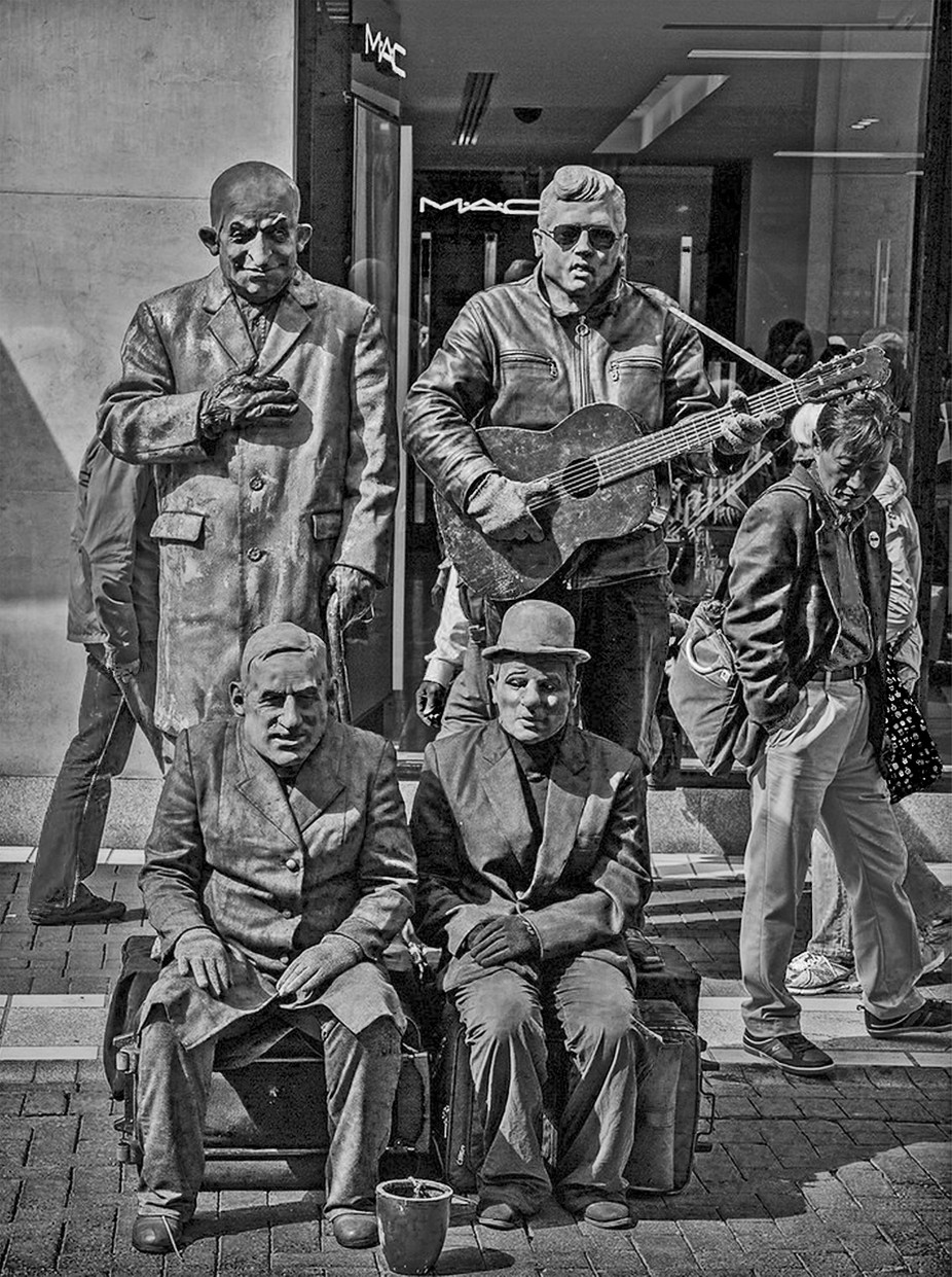 We saw this group of mimes while we were walking down pedestrians-only Grafton Street in Dublin, Ireland. It was a rather warm day so I don't know how they stayed so still, with sweat most likely trickling down their backs! Since I am not presently at home, my only access to this image was a screen grab from my Smugmug gallery.
