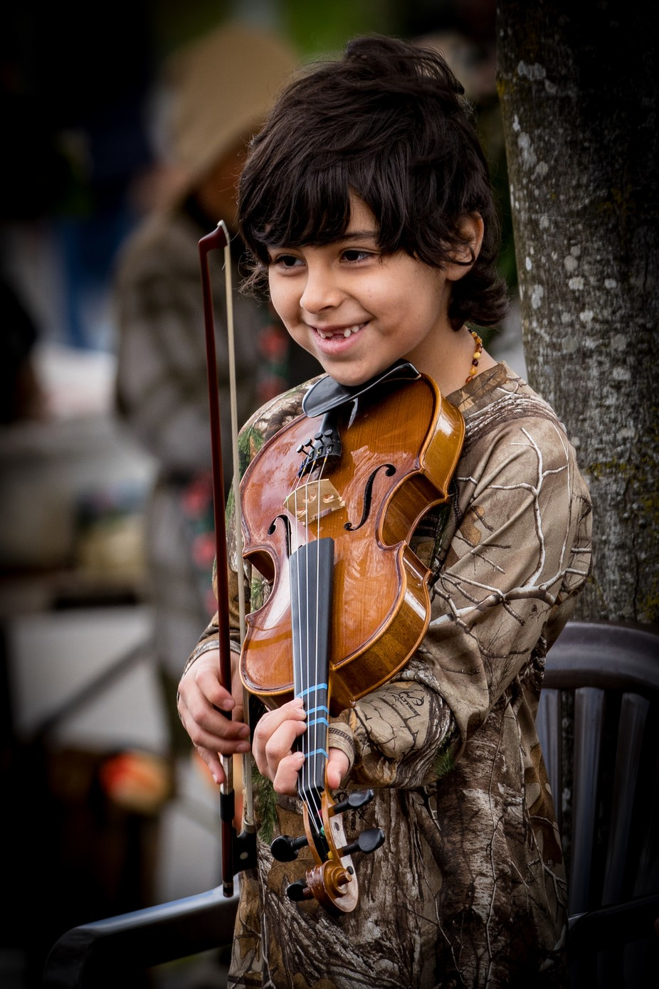 This young man was playing the violin at the Saturday Market in Salem, Oregon