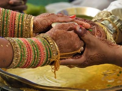Panigraham - offering of brides hand to the groom and acceptance by the groom