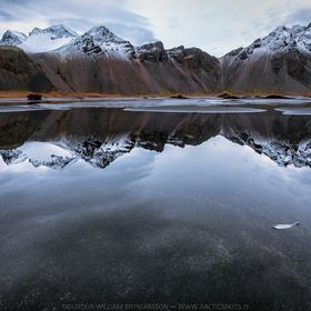 Mt. Vestrahorn reflecting in the water on a cold winter day in Iceland