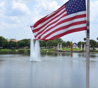 Flag Flying Over the Lake
