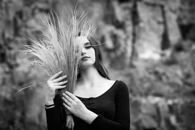 girl with a bouquet of feather grass