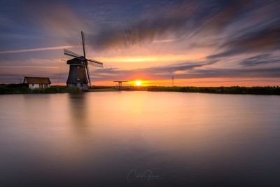 Sunset by windmill Woudaap in the Netherlands