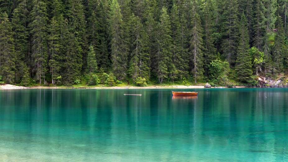I took this photo in the lake of Braies, in the dolomites. it was a rainy day but the lake still...
