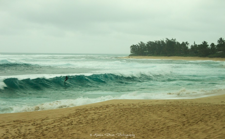 A grey day on the North Shore of Hawaii, but that didn't stop this surfer from having fun.