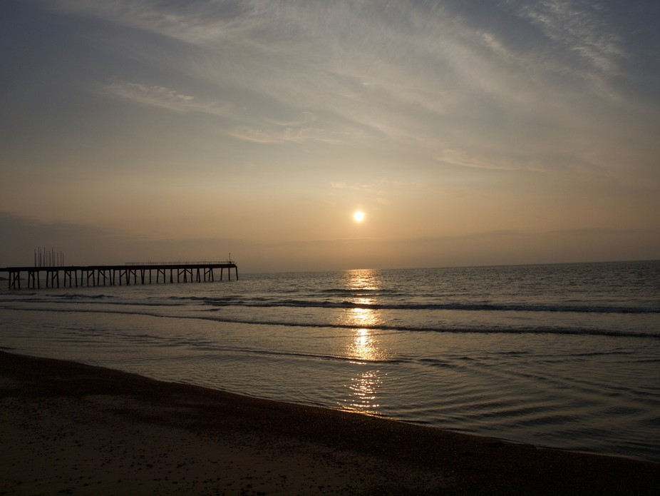I decided to take some pictures of the sunrise over local beach with the pier in the background t...