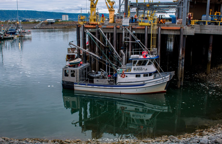 A USGS fishing boat came in to port to off load at the harbor in Homer Alaska.