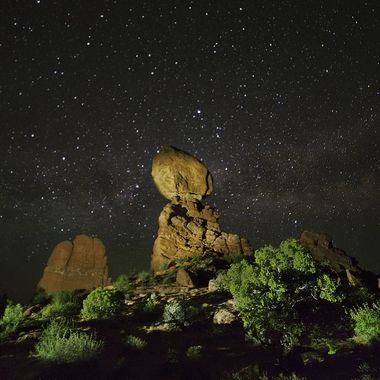 Balanced Rock at Arches National Park, Utah. I did repeated attempts at light painting Balanced Rock and the bushes in front with side light, with the Milky Way in the background. This image was one of my last attempts. Arches National Park has spectacular night skies, yet very few of the day-time visitors come back at night.