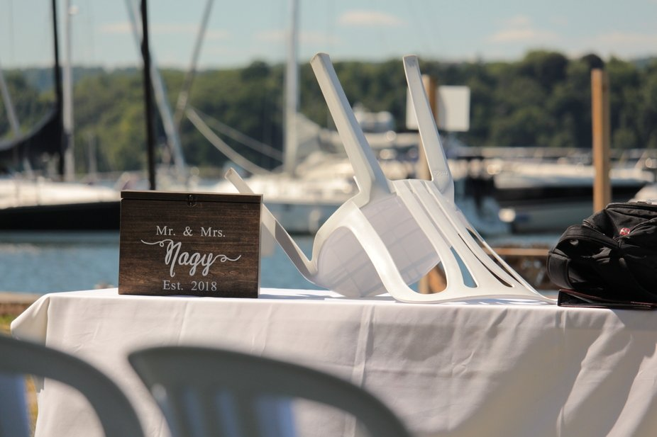 This image was taken shortly before the start of the wedding ceremony. I liked the beautiful box set on a  table and the beautiful waterfront and boats in the background.