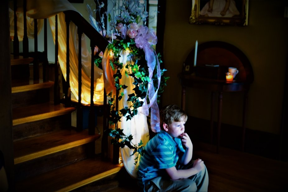 The light on the decorated stairway makes a nice contrast with the child.