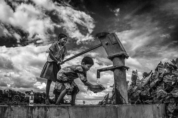 HELPING HANDS by pallabpramanik - Our World In Black And White Photo Contest