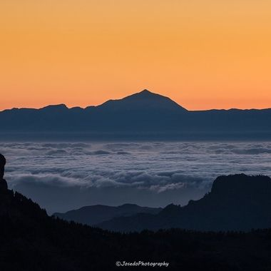 Silhouette of the Volcano Teide and Island of Tenerife, seen from the island of Gran Canaria and Roque Nublo peak at the front.