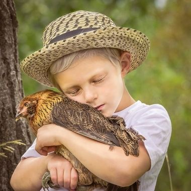 "This child has a pet chicken called ""Speed"" because the chicken can run so very fast."
