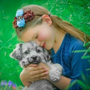 Child with her beloved puppy