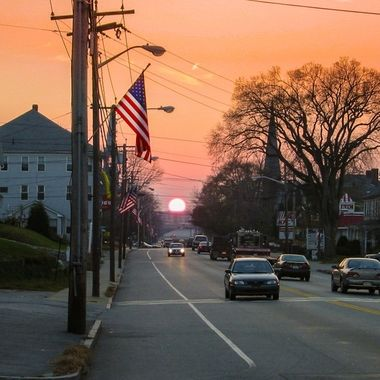 I was driving in the main road in Webster, MA, when I could see in my rear view mirror that the sun was about to set, so I pulled over and took the pic.