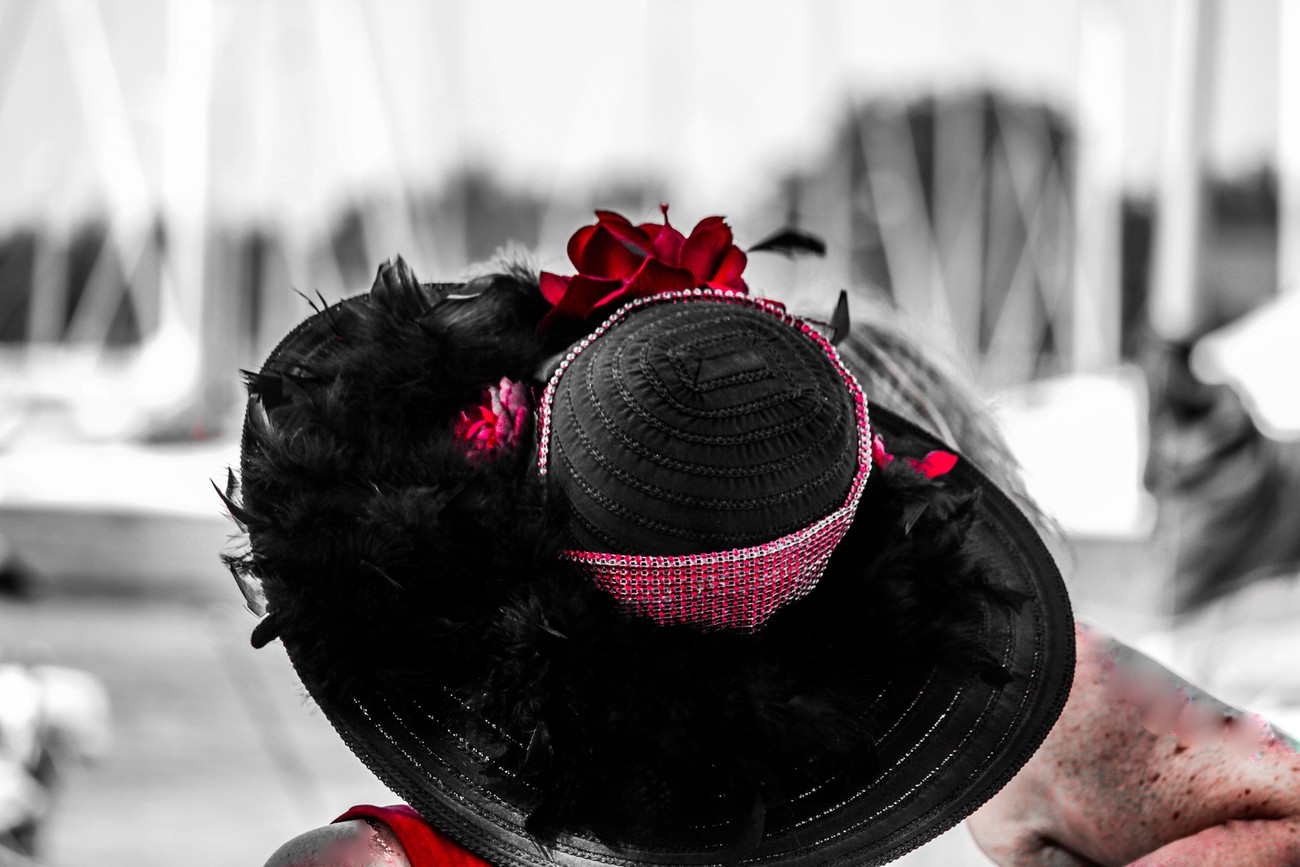 A wedding guest wearing a lovely hat, So I added a pop of extra colour and removed some imperfections. Taken outdoors in the shade but facing direct sunlight.