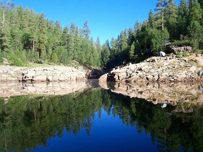 In the middle of the summer in Az the sun comes up at 4:30 am.  You wait two hours looks like noon.  This lake is called blue ridge it is on the Mogollon Rim.