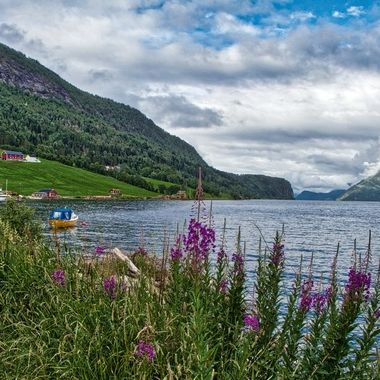 I took this photo when me and my wife went on a boat trip to the Geiranger Fjord, Norway, in July 2018. This lake that we went to is supposed to be the deepest lake in Europe (514 metres).