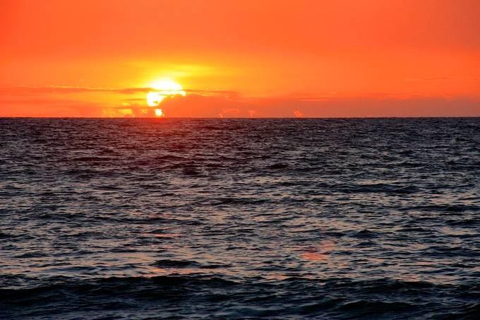 Watching the sun set in Kona, HI.