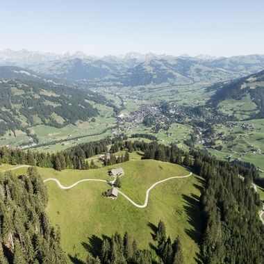 View from my paraglider to Gstaad, Switzerland during a beautiful summer morning.