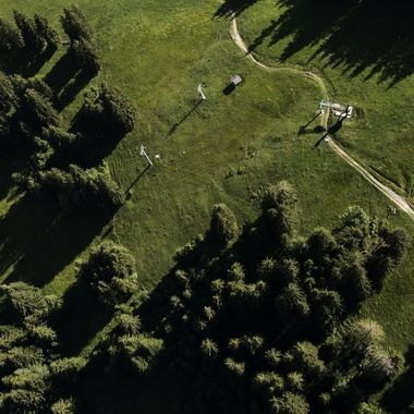 View down from my paraglider on a friend flying lower. Wispile, Gstaad.