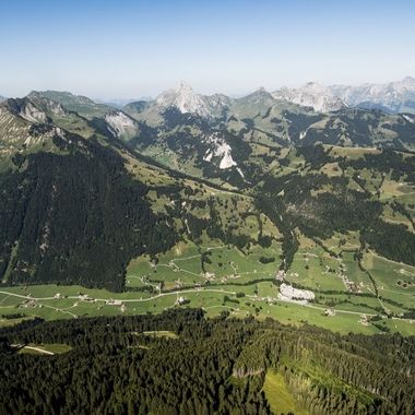 View from the Paraglider down to Grund bei Gstaad and the mountains above.