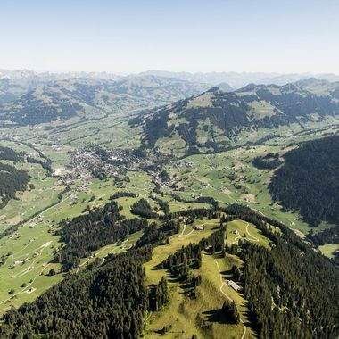 View down to Gstaad from my Paraglider, during a flight above Wispile.