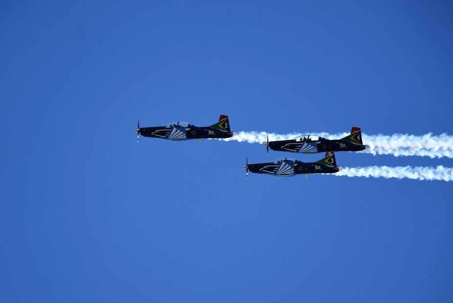 Three Pilatus PC-7 Mk II aircraft of the Silver Falcons (the aerobatic display team of the South ...