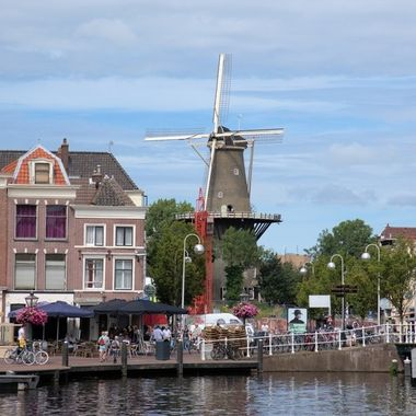 Windmills are everywhere in the Netherlands.  You may find them in the middle of town, as is the case here.